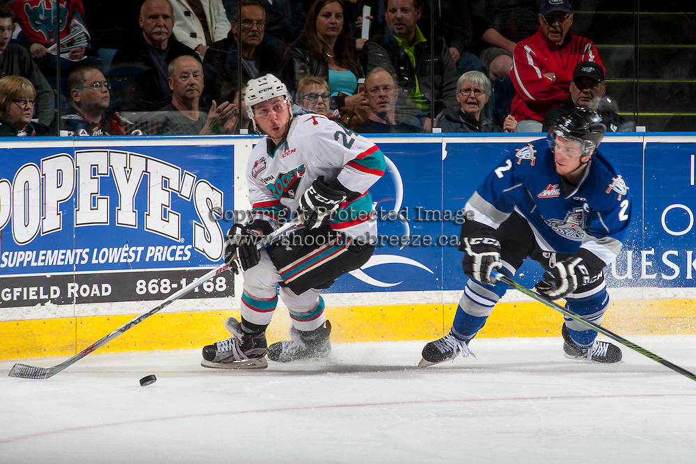 KELOWNA, CANADA - APRIL 14: Joe Hicketts #2 of Victoria Royals checks Tyson Baillie #24 of Kelowna Rockets during the third period on April 14, 2016 at Prospera Place in Kelowna, British Columbia, Canada.  (Photo by Marissa Baecker/Shoot the Breeze)  *** Local Caption *** Joe Hicketts; Tyson Baillie;