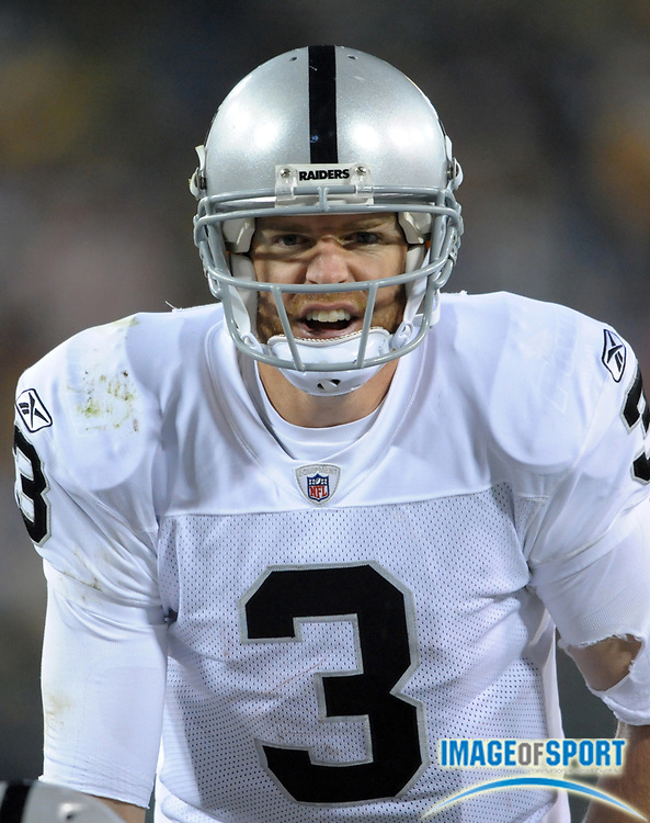 Dec 11, 2011; Green Bay, WI, USA; Oakland Raiders quarterback Carson Palmer (3) reacts during the game against the Green Bay Packers at Lambeau Field. The Packers defeated the Raiders 46-16.