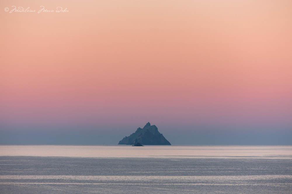 Colourful sunrise over Skellig Michael, Little Skellig and Lemon Rock as seen from St. Finian's Bay Beach, County Kerry, Ireland. <br />