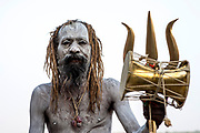 Aghoris smear themselves with the white ashes of cremated hindus.