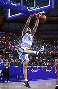 Tall Blacks forward Sean Marks makes a slam dunk during the basketball match between New Zealand and China at the Olympic Games, Sydney Australia, 2000. Photo: PHOTOSPORT<br />