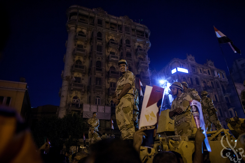 """Egyptian soldiers stand atop an APC during mass demonstrations called for by Gen. Abdel Fattah El Sissi, the head of Egypt's military, in the Tahrir Square area of downtown Cairo Egypt on Friday July 26, 2013. EL Sissi had asked Egyptians to take to the streets on Friday to show the world that he had a mandate to deal with """"violence and terrorism"""", ahead of what many believe is a planned crackdown on the Muslim Brotherhood political group."""