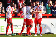 John Mousinho of Stevenage (right) celebrates scoring his team's third goal with Francois Zoko of Stevenage (2nd right) during the Sky Bet League 1 match at the Lamex Stadium, Stevenage<br /> Picture by David Horn/Focus Images Ltd +44 7545 970036<br /> 08/03/2014