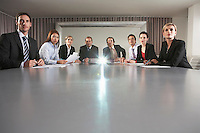 Businesspeople Watching Presentation in Conference Room