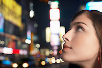 Young Woman on Nighttimes City Street close up profile