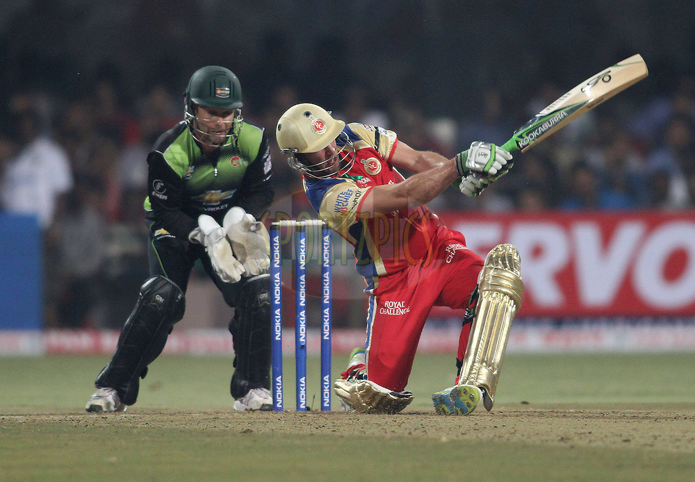 AB de Villiers of Royal Challengers Bangalore slog sweeps a delivery for six during match 1 of the NOKIA Champions League T20 ( CLT20 )between the Royal Challengers Bangalore and the Warriors held at the  M.Chinnaswamy Stadium in Bangalore , Karnataka, India on the 23rd September 2011..Photo by Shaun Roy/BCCI/SPORTZPICS