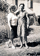 two adult women posing in garden France ca 1960s