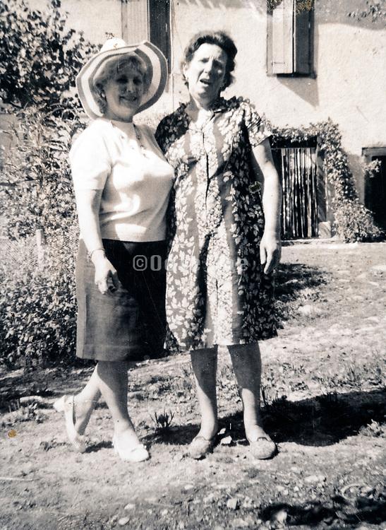 two adult women posing in garden France ca 1960s