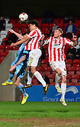 Troy Brown heads the ball clear during the Sky Bet League 2 match between Cheltenham Town and Cambridge United at Whaddon Road, Cheltenham, England on 14 April 2015. Photo by Alan Franklin.