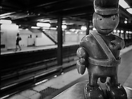 Policeman from Tom Otterness' installation Life Underground at the 14th Street – Eighth Avenue subway station, New York City.