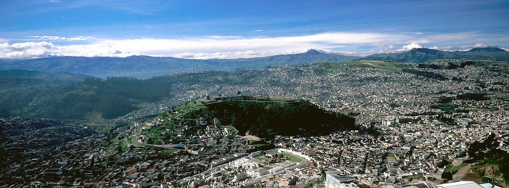 ECUADOR, QUITO, SKYLINE Quito with Cotopaxi volcano
