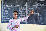 Teacher Rebecca Ngovano  talks to students during a class taken with VSO volunteers Paul Jennings. Paul has been working with Rebecca for over 6 months to improve teaching methodologies in classrooms. Angaza school, Lindi, Tanzania