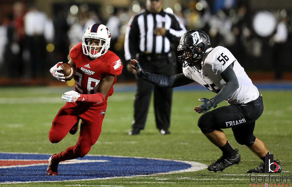 Bishop Dunne's Donald Gamble runs past Michael Menditto during the TAPPS Division I state championship game on Saturday, Dec. 3, 2016 at Panther Stadium in Hewitt, Texas. Bishop Lynch High School won 21-17. (Photo by Kevin Bartram)