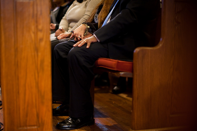 CHEVERLY, MD - DECEMBER 6: Prince George's County Executive-Elect Rushern Baker III holds his wife's hand during an interfaith service at Cheverly United Methodist Church on his inauguration day on December 6, 2010 in Cheverly, Maryland. (Photo by Michael Starghill, Jr.)