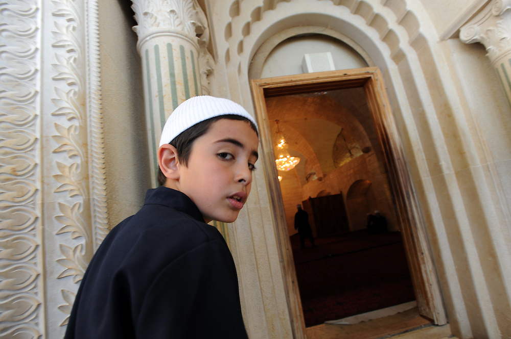 "An Israeli Druze child attends the celebrations of Nabi Shuayb Druze holiday at the tomb of Nabi Shuayb (meaning ""the Prophet Jethro""), the site in the destroyed village of Hittin not far from Tiberias, where the tomb of the Islamic prophet Shu'ayb (Biblical Jethro) is believed to be located. During the festivities, mass celebrations are held at Nabi Shu'ayb, and Druze religious leaders gather there for ritual purposes and to discuss religious questions. Photo by Gili Yaari"