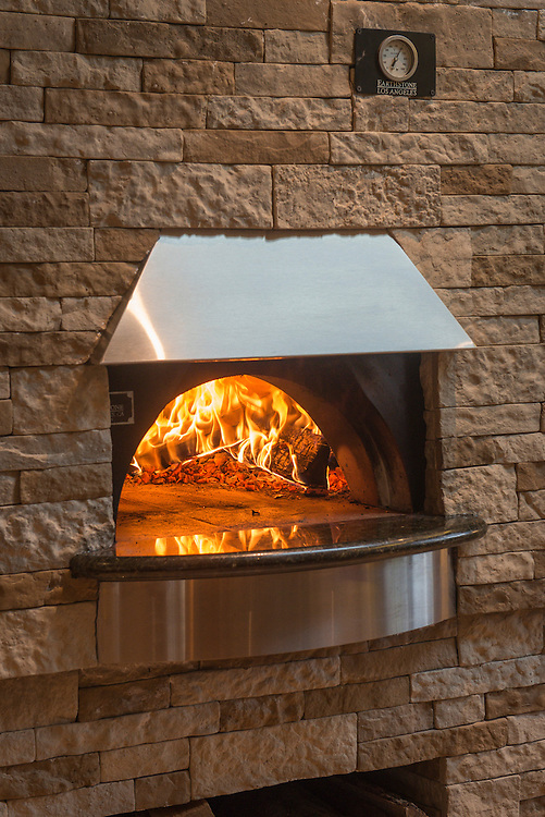 Wood burns in the newly completed pizza oven at the home of Andrew and Erin Blank in Moorestown Twp, Friday, March 28, 2014. (PHOTO Bryan Woolston / @woolstonphoto)