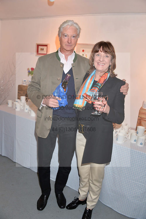 PRINCE NICHOLAS VON PREUSSEN and JOANNA WOOD at an exhibition of works by Beatrice von Preussen held at The Gallery on The Corner, 155 Battersea Park Road, London SW8 on 11th December 2013.