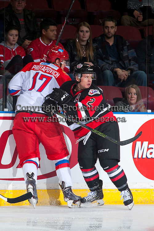 KELOWNA, CANADA - NOVEMBER 9: Joe Hicketts #2 of Team WHL checks Alexander Protapovich #17 of Team Russia into the boards on November 9, 2015 during game 1 of the Canada Russia Super Series at Prospera Place in Kelowna, British Columbia, Canada.  (Photo by Marissa Baecker/Western Hockey League)  *** Local Caption *** Alexander Protapovich; Joe Hicketts;