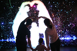 May 2, 2019 - Shandong, China - Visitors view a holographic light show in the Qingdao West Coast New Area in Qingdao, east China's Shandong Province, during the Labor Day national holiday. (Credit Image: © Xinhua via ZUMA Wire)