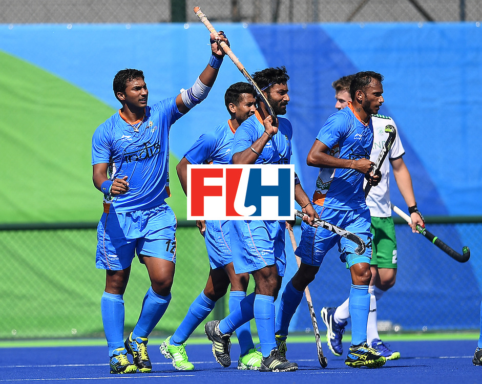 India's Raghunath Vokkaliga (L) celebrates scoring a goal during the men's field hockey India vs Ireland match of the Rio 2016 Olympics Games at the Olympic Hockey Centre in Rio de Janeiro on August, 6 2016. / AFP / MANAN VATSYAYANA        (Photo credit should read MANAN VATSYAYANA/AFP/Getty Images)