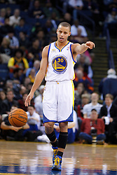 Jan 25, 2012; Oakland, CA, USA; Golden State Warriors point guard Stephen Curry (30) dribbles the ball against the Portland Trail Blazers during the first quarter at Oracle Arena. Golden State defeated Portland 101-93. Mandatory Credit: Jason O. Watson-US PRESSWIRE