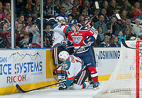 KELOWNA, CANADA - MARCH 28: Riley Hillis #3 of Tri-City Americans gets tangled with Nick Merkley #10 after a check on Rourke Chartier #14 of Kelowna Rockets on March 28, 2015 at Prospera Place in Kelowna, British Columbia, Canada.  (Photo by Marissa Baecker/Shoot the Breeze)  *** Local Caption *** Riley Hillis; Nick Merkley; Rourke Chartier;