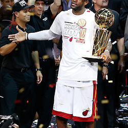 Jun 20, 2013; Miami, FL, USA; Miami Heat guard LeBron James celebrates with the Larry O' Brien Championship trophy after game seven in the 2013 NBA Finals at American Airlines Arena. Miami defeated the San Antonio Spurs 95-88 to win the NBA Championship. Mandatory Credit: Derick E. Hingle-USA TODAY Sports
