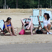 UK Weather: People sitting in a Deckchairs as Heatwave continues in Hype park, London, UK. July 26 2018.
