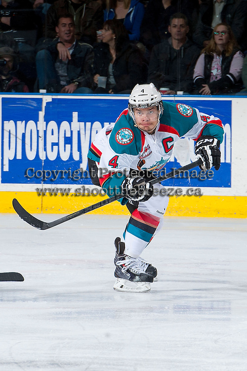 KELOWNA, CANADA - JANUARY 4: Madison Bowey #4 of the Kelowna Rockets passes the puck against the Vancouver Giants on January 4, 2014 at Prospera Place in Kelowna, British Columbia, Canada.   (Photo by Marissa Baecker/Shoot the Breeze)  ***  Local Caption  ***