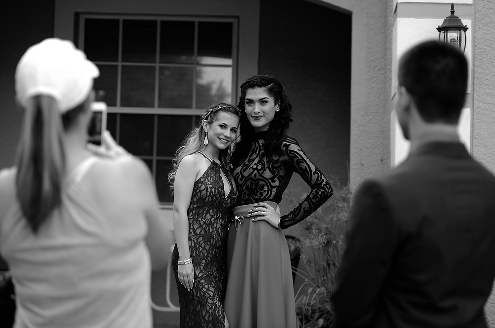 Ariel Zavala, right, and her friend Alexis Berrios pose for photographs outside Ariel's home Saturday, April 30, 2016 in Tampa. Zavala who is transitioning from male to female attended her prom for Alonso High School on Saturday. CHRIS URSO/STAFF