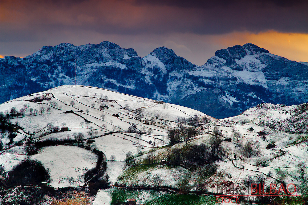 Snow-capped mountains..Alisas port. Cantabria, Spain.