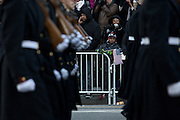 Spectators watch the inauguration parade for Pres. Barack Obama on January 21, 2013 in Washington, D.C.