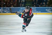 KELOWNA, CANADA - DECEMBER 3: Riley Stadel #3 of Kelowna Rockets takes a slap shot against the Saskatoon Blades on December 3, 2014 at Prospera Place in Kelowna, British Columbia, Canada.  (Photo by Marissa Baecker/Shoot the Breeze)  *** Local Caption *** Riley Stadel;