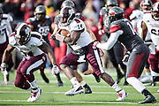 LITTLE ROCK, ARKANSAS - NOVEMBER 23:  Damian Williams #14 of the Mississippi State Bulldogs runs the ball for a touchdown in overtime against the Arkansas Razorbacks at War Memorial Stadium on November 23, 2013 in Little Rock, Arkansas.  The Bulldogs defeated the Razorbacks 24-17.  (Photo by Wesley Hitt/Getty Images) *** Local Caption *** Damian Williams