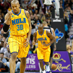 January 22, 2011; New Orleans, LA, USA; New Orleans Hornets power forward David West (30) reacts after scoring against the San Antonio Spurs during the third quarter at the New Orleans Arena. The Hornets defeated the Spurs 96-72.  Mandatory Credit: Derick E. Hingle