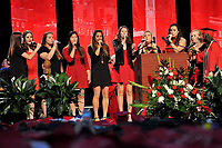 The Ladies In Red perform at commencement.