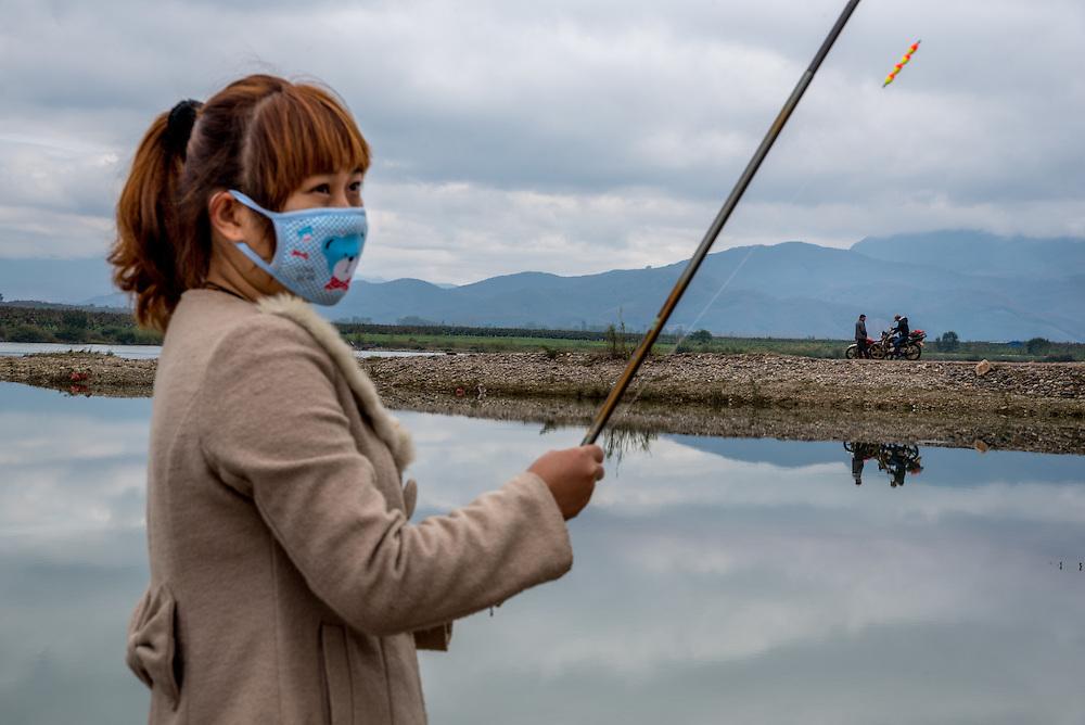 Residents fish in the Lancang (Mekong) river near Manhenuan village, Xishuangbanna, China.