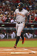 PHOENIX, AZ - MAY 14:  Denard Span #2 of the San Francisco Giants is brought in by Joe Panik (not pictured) in the first inning against the Arizona Diamondbacks at Chase Field on May 14, 2016 in Phoenix, Arizona.  (Photo by Jennifer Stewart/Getty Images)