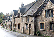 A row of attractive stone cottages in Castle Combe, Wiltshire, England, UK claimed to be England's prettiest village