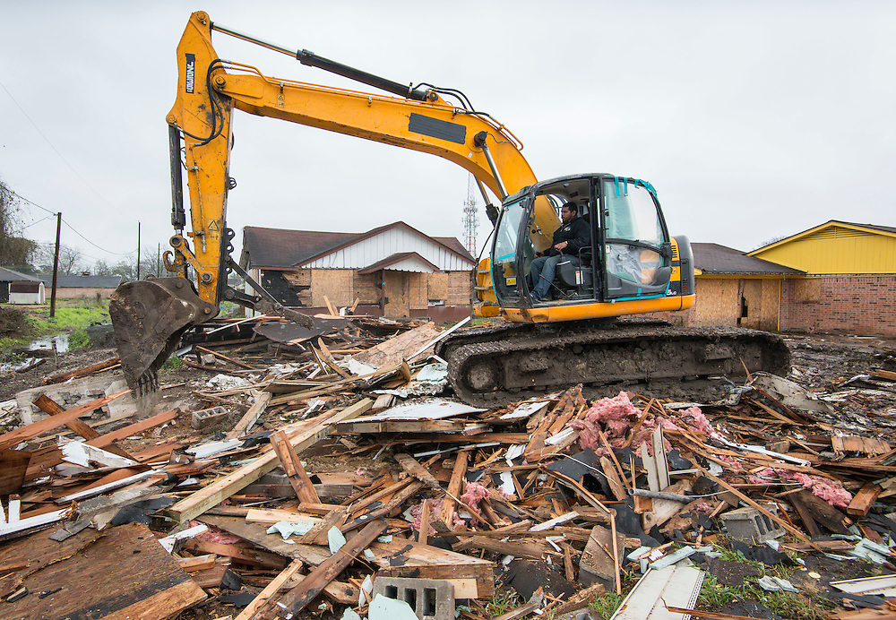 Demolition crews begin clearing condemned houses to make way for the new Washington High School, March 13, 2015.
