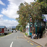 A street scene in Rawene . Rawene is a town on the south side of the Hokianga harbour, in Northland,  A car ferry links it to Kohukohu and the northern Hokianga. Rawene started as a timber centre, with a mill and shipyards established in the early 19th century. Rawene, Northland, New Zealand. 22nd November 2011.  Photo Tim Clayton.