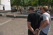 Dealer arrêté par  la police pendant  une descente - du  hasjh et de l'argent ont été trouvés dans son sac,  quartier  Font Vert (Marseille)...Font Vert est une des cités les plus pauvres dans la ville, utilisée comme une base pour le trafic de drogue à grande échelle. Dans les quartiers du Nord le  trafic de drogue est florissante, conduisant à des reglements de compte par des groupes de dealers concurrents.