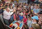 12/12/2012 Luna Park 100th Birthday celebrations. Lindsay Fox cutting the Luna Park cake.Photo By Craig Sillitoe This photograph can be used for non commercial uses with attribution. Credit: Craig Sillitoe Photography / http://www.csillitoe.com<br />