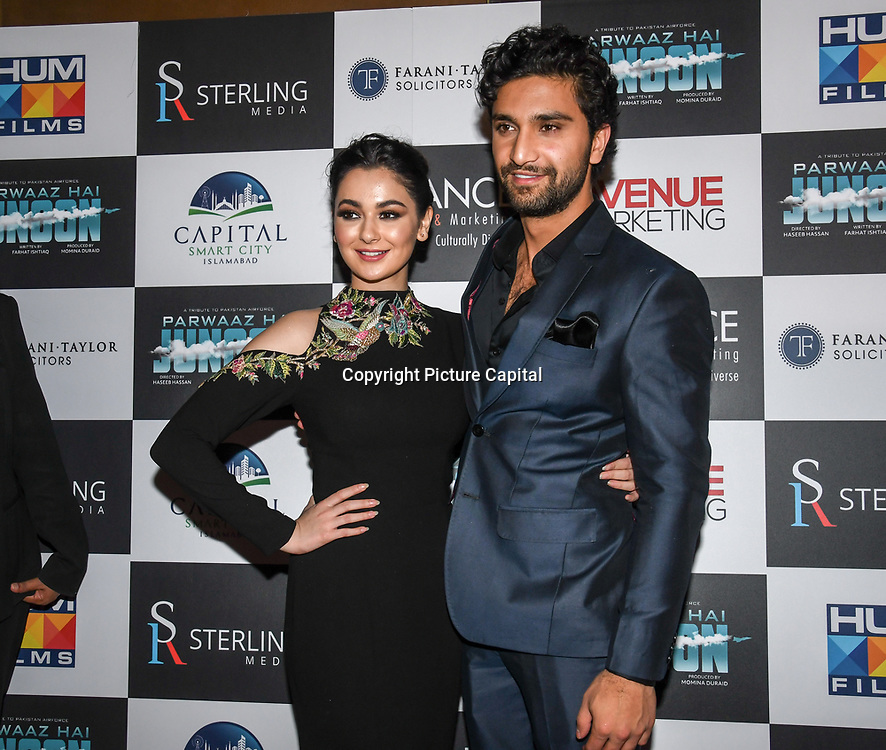 """Hania Amir and Ahad Raza Mir attend Photocall in London Premiere of """"Parwaaz Hai Junoon"""" (Soaring Passion) as featured on SKY, ITV at The May Fair Hotel, Stratton Street, London, UK. 22 August 2018."""