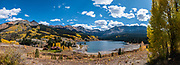 Fall foliage colors at Trout Lake, in the San Juan Mountains, Uncompahgre National Forest, Telluride, Colorado, USA. At center is Vermilion Peak (13,894 ft elevation). This image was stitched from multiple overlapping photos.