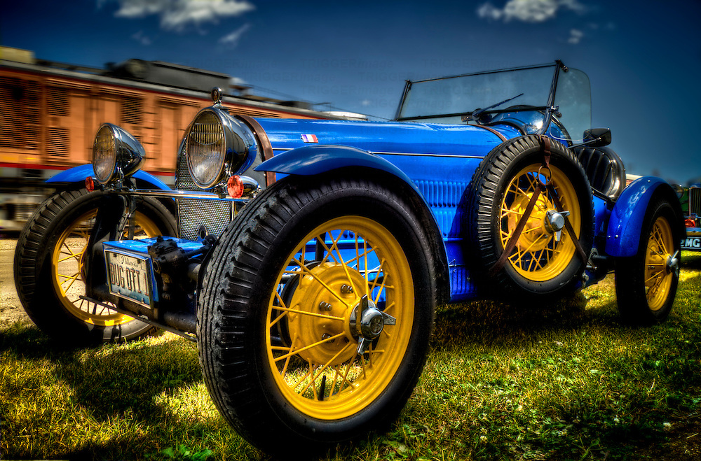 Bugatti period car reproduction in blue with yellow spoked wheels