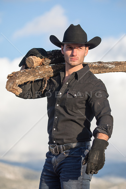 Chiseled cowboy carrying wood