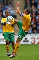 Photo: Richard Lane/Richard Lane Photography. Coventry City v Norwich City. Coca-Cola Championship. 09/08/2008. Norwich's Elliott Omosuzi and Mark Fotheringham (rt) both challenge for the same ball.