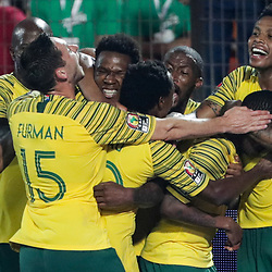06 July 2019, Egypt, Cairo: South Africa's Thembinkosi Lorchc celebrates scoring his side's first goal with teammates during the 2019 Africa Cup of Nations round of 16 soccer match between Egypt and South Africa at Cairo International Stadium. Photo : PictureAlliance / Icon Sport