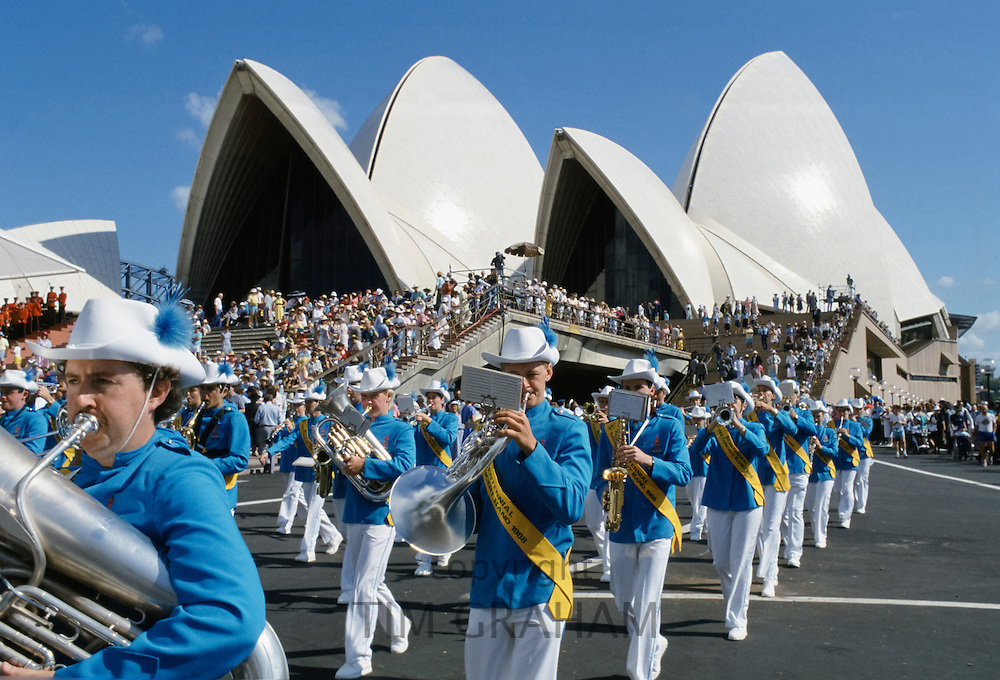 Carnival parade and musical band for celebrations at Sydney Opera House by Sydney Harbour Bridge for Australia's Bicentenary,1988